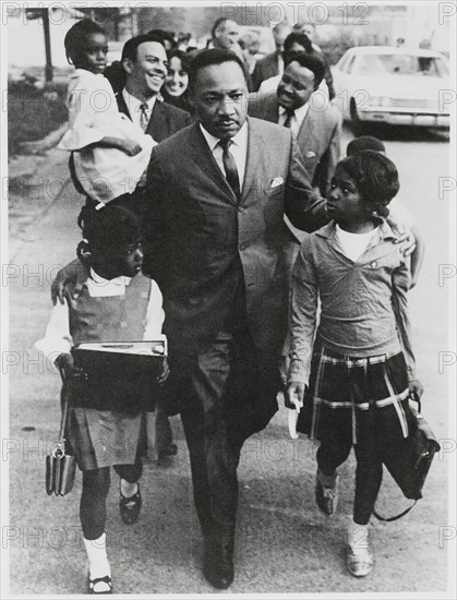 Martin Luther King Jr. Escorting Schoolchildren to Newly Integrated School, Andrew Young, Joan Baez and Hosea Williams in Background, Grenada, Mississippi, USA, September 20, 1966
