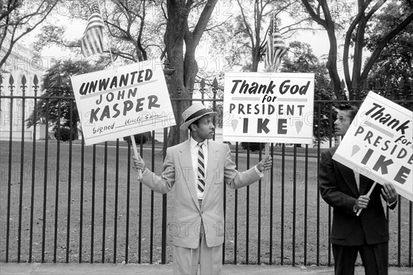 Two Men Protesting John Kasper, an American far-right activist and Ku Klux Klan member who took a militant stand against racial integration during the civil rights movement, Washington, D.C., USA, photograph by Thomas J. O'Halloran, October 1957