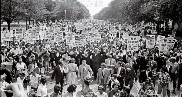 Leaders of the 1963 March on Washington for Jobs and Freedom raise their hands together as they move along Constitution Avenue in Washington, DC on August 28, 1963. Some of the leaders in the march, from left to right, include John Lewis, Mathew Ahmann, Roy Wilkins, Dr. King, Rabbi Joachim Prinz, A. Philip Randolph, and Whitney Young. Credit: Arnie Sachs/CNP /MediaPunch