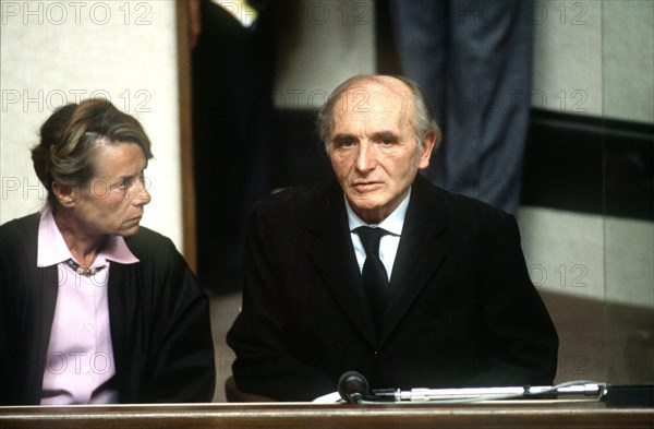 (dpa files) - Klaus Barbie, former German Secret State police (Gestapo) of the city of Lyon, sits with a translator during his trial in a court room in Lyon, France, 11 May 1987. Barbie was accused of crimes against humanity.