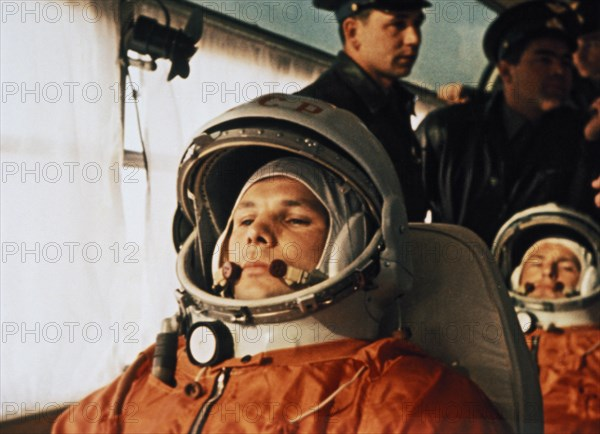 Cosmonaut yuri gagarin on a bus on the way to the launch site of vostok i april 12, 1961, seated behind him is his substitute, gherman titov.
