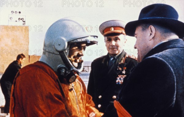 Cosmonaut yuri gagarin shaking hands with rocket designer korolev (right) at baikonur, just before his flight into space, april 1961.