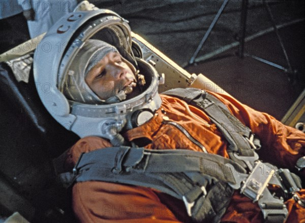 Cosmonaut yuri gagarin during last minute checks of vostok i control systems before launch, 1961.