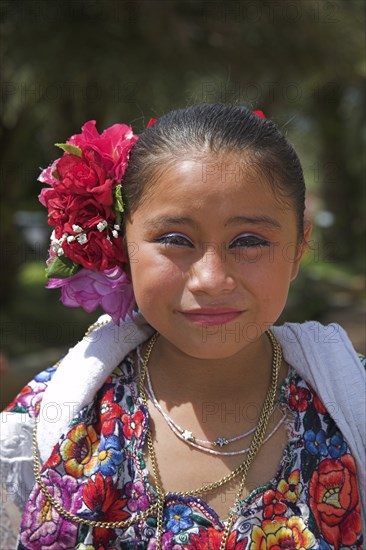 MEXICO, Yucatan, Chichen Itza, Young Mexican girl wearing traditional costume